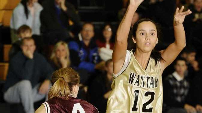 Wantagh's April Iannetta passes the ball guarded by
