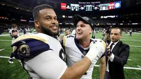 Aaron Donald #93 and Greg Zuerlein #4 of