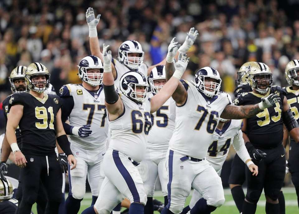 Los Angeles Rams players celebrate after overtime of