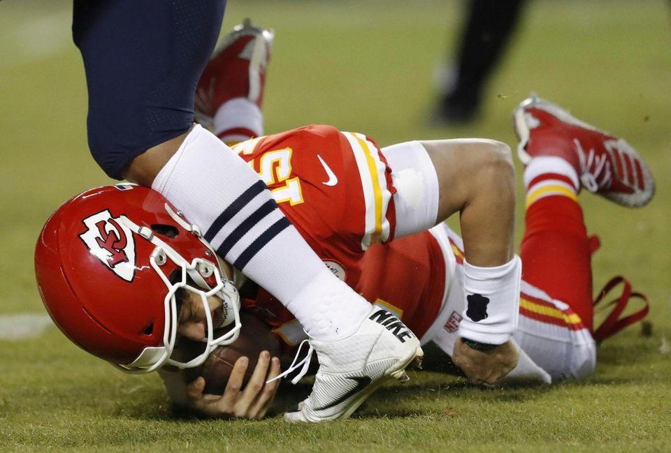 A player runs into Kansas City Chiefs quarterback