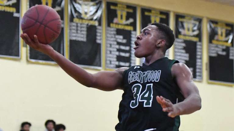 Brentwood's Bryce Harris puts up a layup against