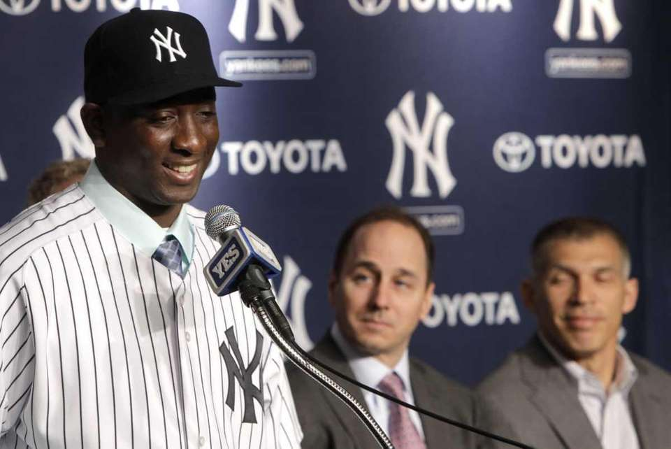 Reliever Rafael Soriano, left, smiles during a news