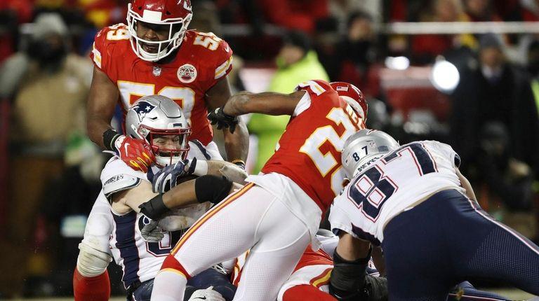 New England Patriots running back Rex Burkhead dives