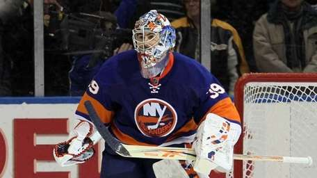 Islanders goaltender Rick DiPietro in action against the