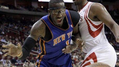 Houston Rockets' Chuck Hayes, right, knocks the ball