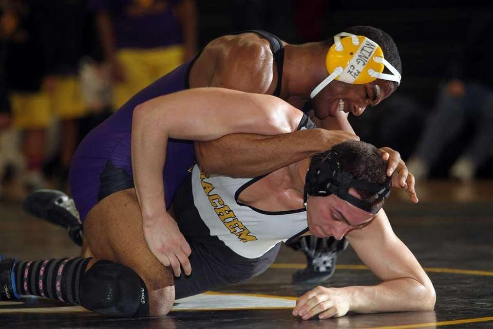 Central Islip's Julian Ming controls Sachem's Anthony Marino