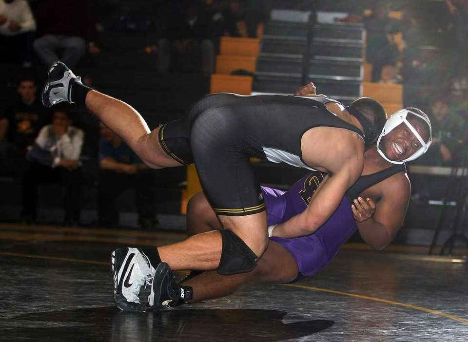 Sachem's Mike McCarthy scores a takedown of Central