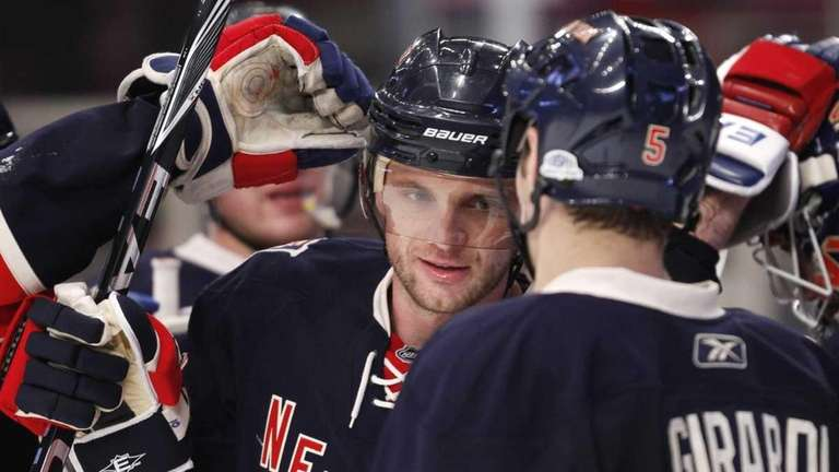 New York Rangers congratulate teammate Marian Gaborik, center,