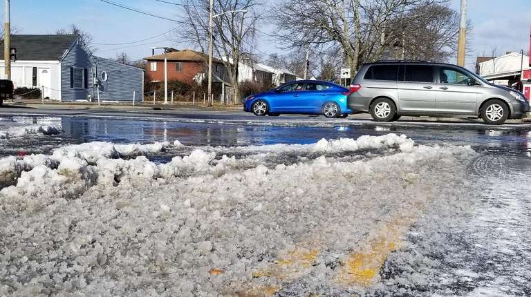 Ice forms after a water main break in