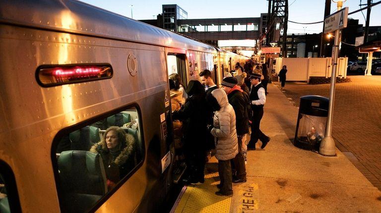 Riders board a Long Island Rail Road train
