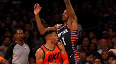 Frank Ntilikina of the Knicks defends against Russell