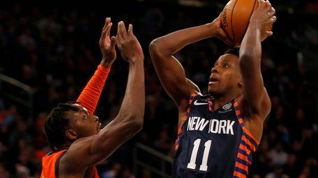 Frank Ntilikina of the Knicks puts up a
