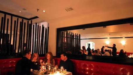 Patrons dine at Philippe, an upscale Chinese restaurant