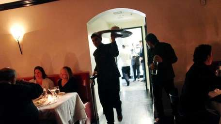 Patrons dine at Philippe, an upscale Chinese restaurant,