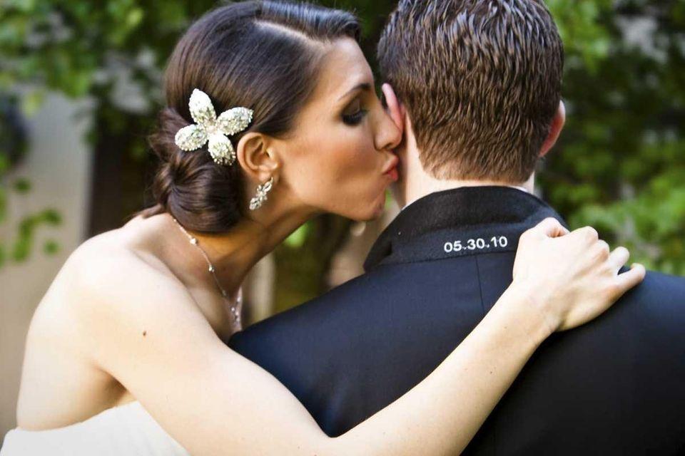 Danielle Kalman gives Ross Zeifman a kiss during