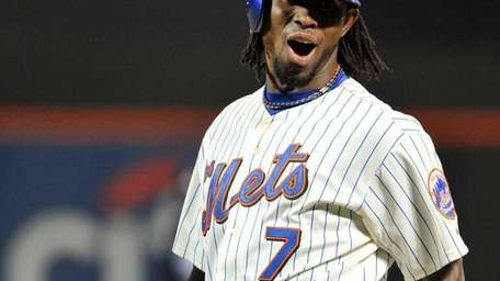 Mets shortstop Jose Reyes reacts after hitting an