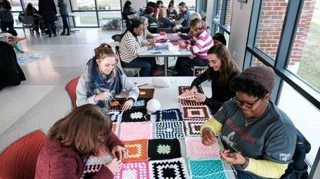 Volunteers participate in Project Chemo Crochet during a