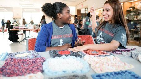 Kimoya Brown, 11, left, and Angie Rivera, 13,