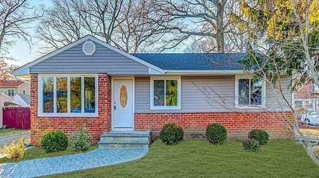 This Bay Shore ranch, for $389,000, includes three