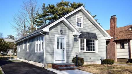 This Malverne Cape, for $449,000, includes two bedrooms