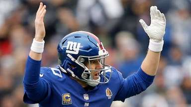 Eli Manning against the Dallas Cowboys at MetLife