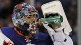 Rick DiPietro takes a drink of water against