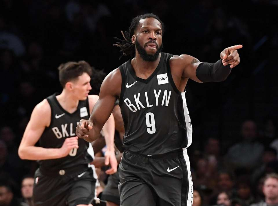Brooklyn Nets forward DeMarre Carroll reacts after sinking
