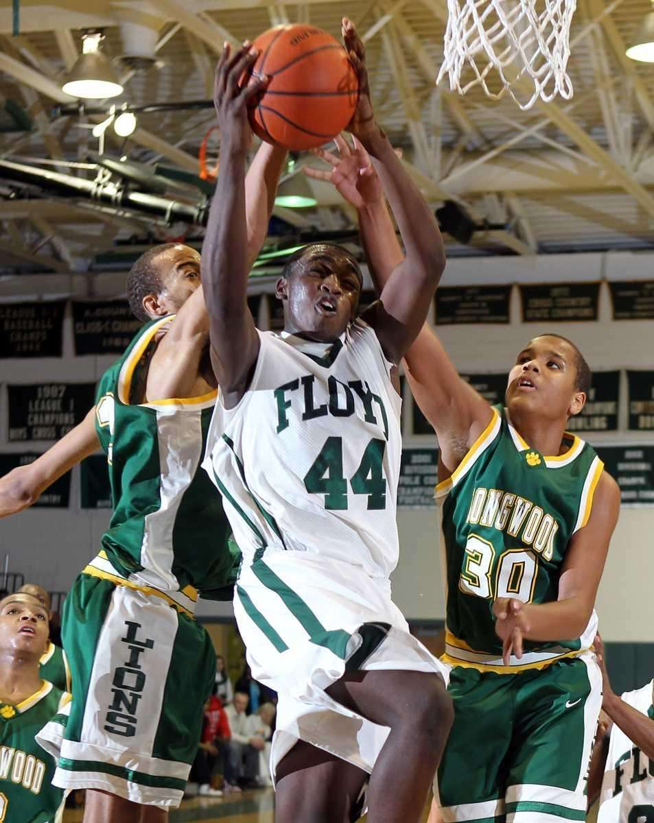 Floyd's Anthony White (44) powers to the hoop