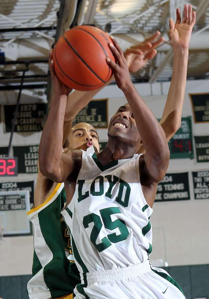 Floyd's Shabazz Thompkins (25) is fouled on the
