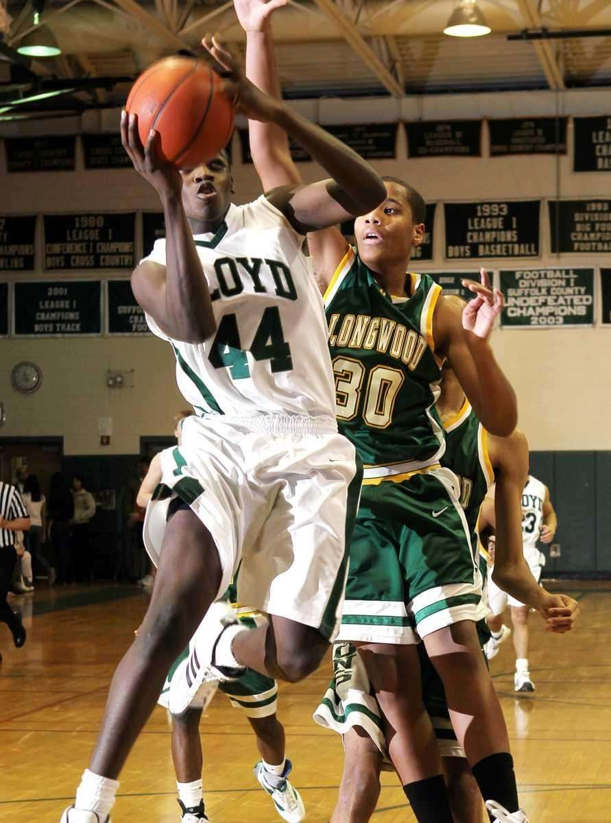 Floyd's Anthony White (44) drives to the hoop
