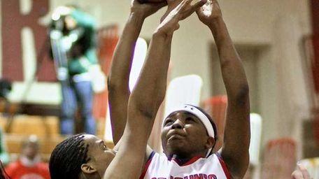 St. John forward Brianna Thomas #14 pulls up