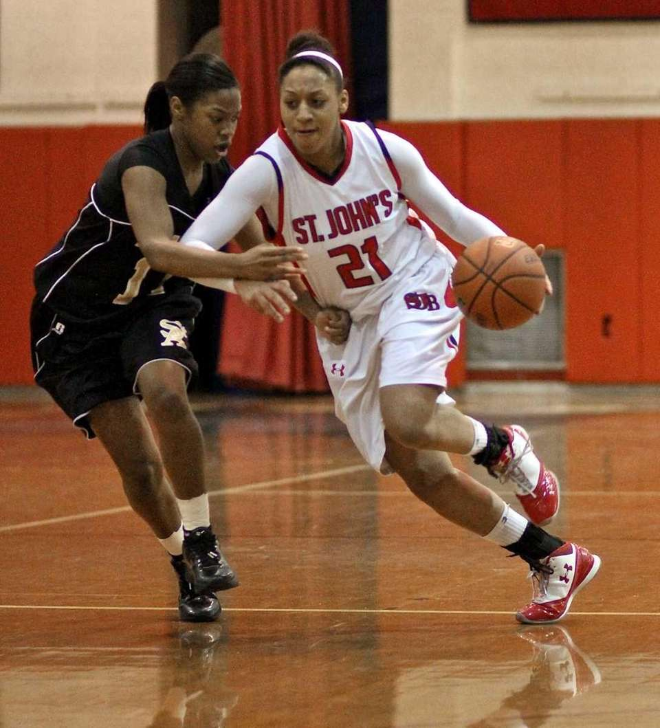 St. John forward Alexis Smith #21 drives the