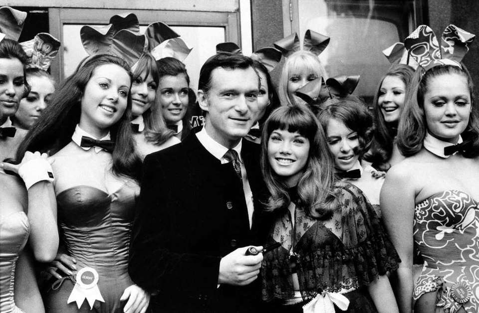 Hugh Hefner and girlfriend Barbi Benton are surrounded