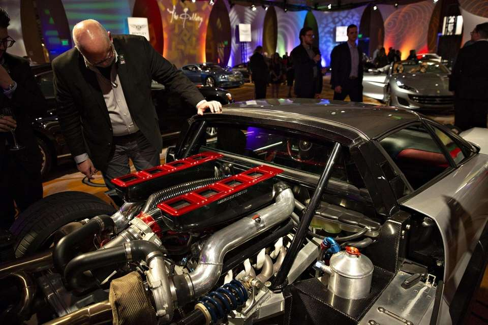 An attendee looks at the engine of a