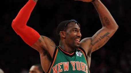 Knicks center Amar'e Stoudemire reacts to the crowd
