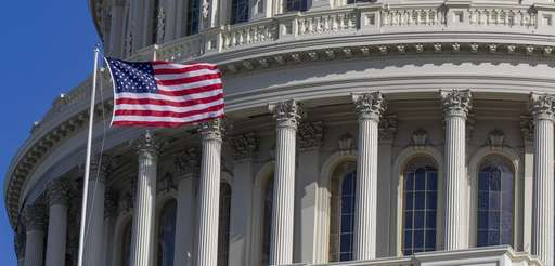 An American flag flies on the U.S. Capitol