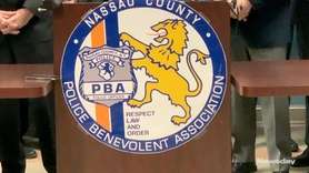 Police Benevolent Association president James McDermott and other law