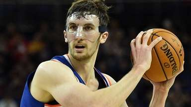 The Knicks' Luke Kornet prepares to pass against