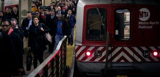 Metro-North passengers disembark at Grand Central Terminal.