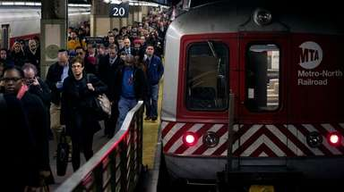Metro-North passengers disembark at Grand Central Terminal.