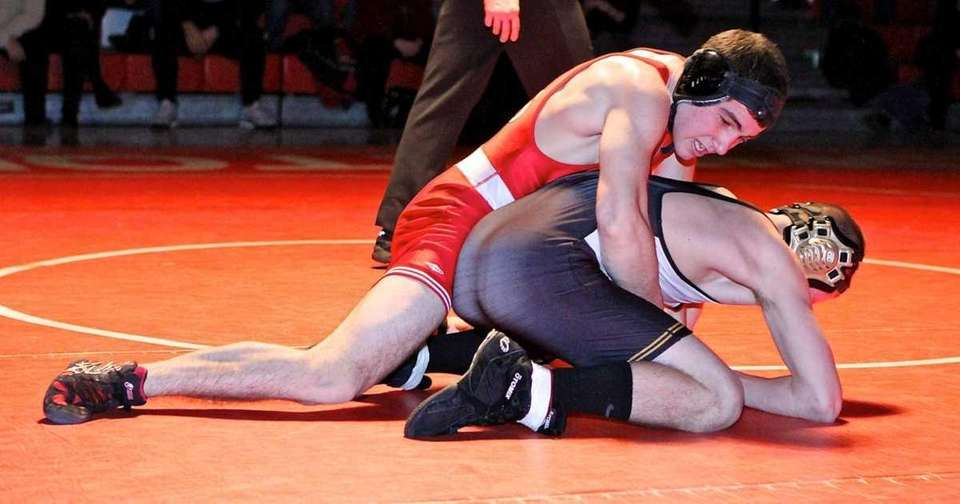 Connetquot's Steven Schmitt moves on Sachem North's Nick