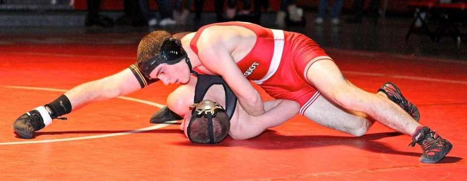 Connetquot's Steven Schmitt goes for the pin against