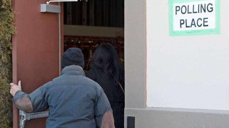 Residents arrive to vote on the fate of