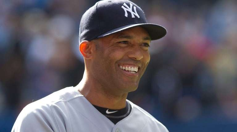 Yankees closer Mariano Rivera smiles after tying the