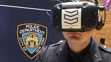 An NYPD officer models virtual-reality goggles used in