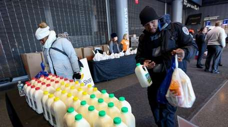 Furloughed federal workers receive food and supplies from