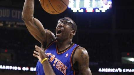 New York Knicks forward Amare Stoudemire, left, dunks