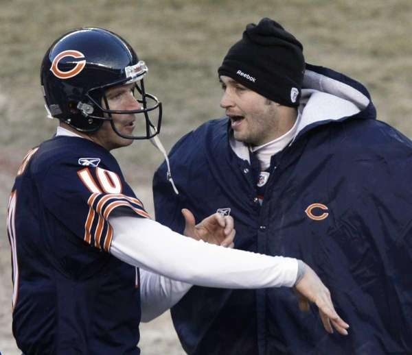 Chicago Bears quarterback Jay Cutler. right, talks with