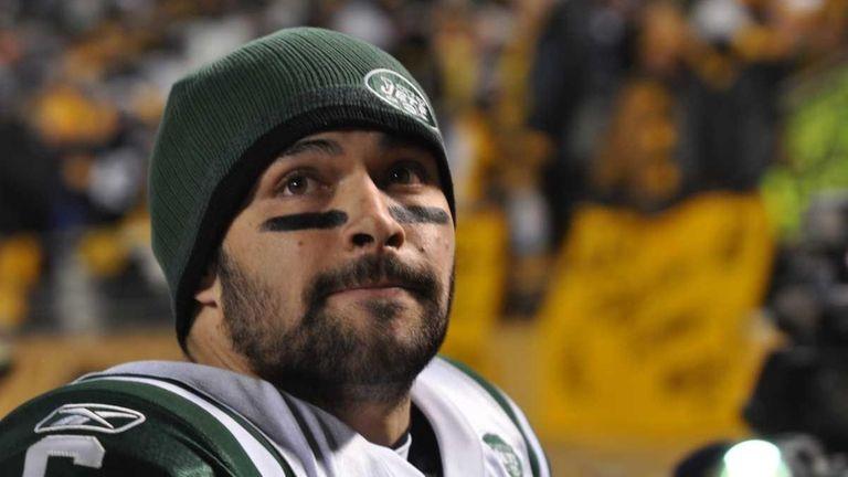 Jets quarterback Mark Sanchez reacts to losing the