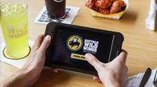 At Buffalo Wild Wings, you'll find tablets for
